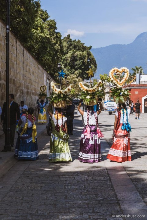 Women in colorful dresses on their way to an Oaxacan wedding.