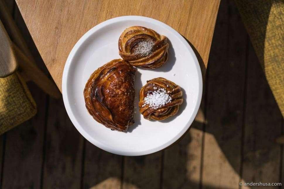 Clockwise: the cardamom bun, cinnamon bun, and apple chausson from Karjase Sai.