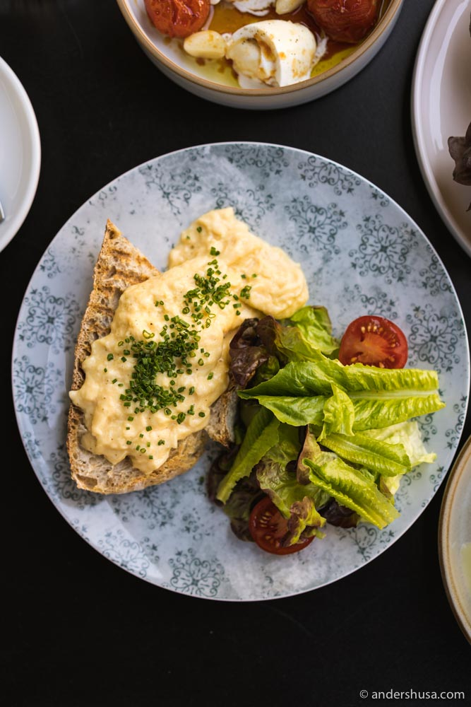 Delicious scrambled eggs served on their sourdough bread.