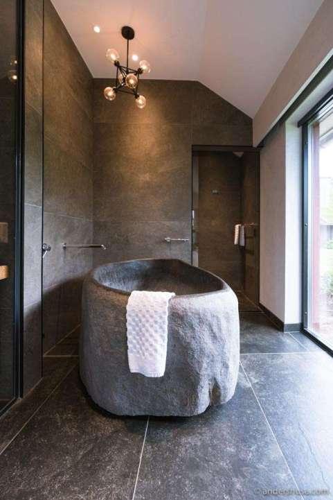 The beautiful stone bathtub at Ästad Vingård, next to our private sauna.