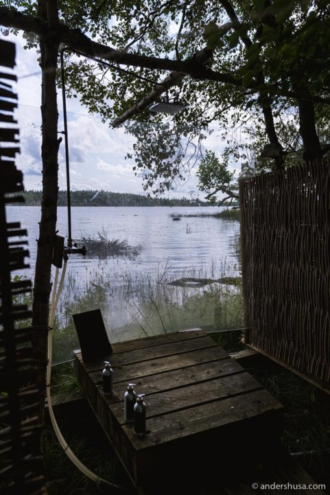 The showers are communal and use water from the lake.