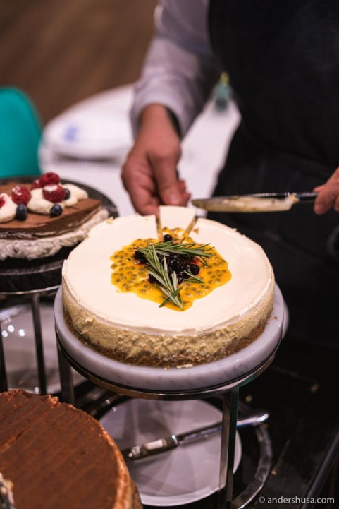 Cheesecake with passionfruit on the dessert trolley.