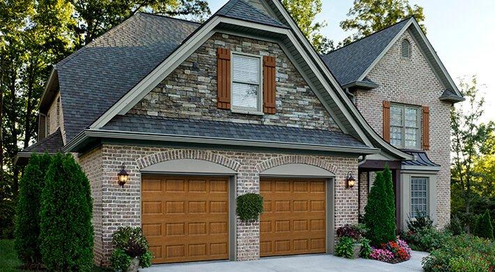 stratford wooden garage doors on a house