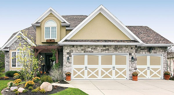 beautiful tan garage door with white molding in Logan, Ut