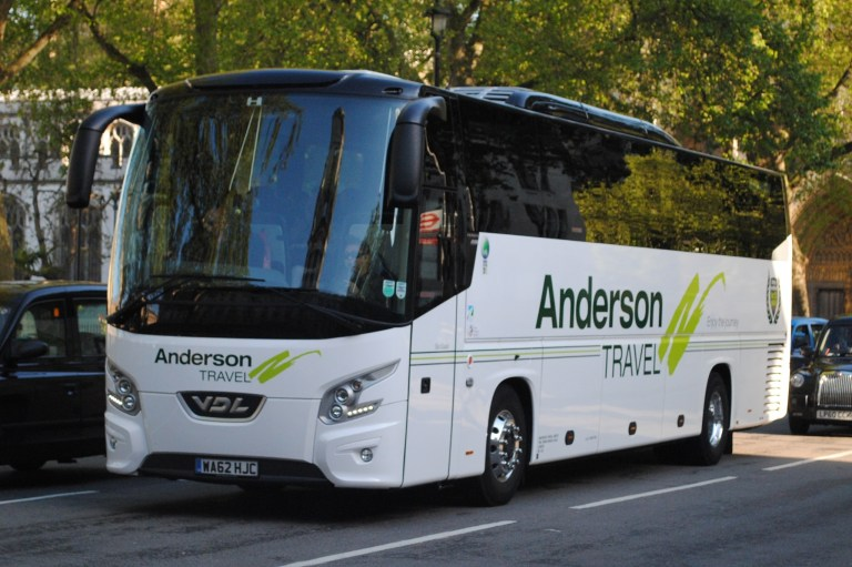 Anderson Travel White Coach with Green Logo