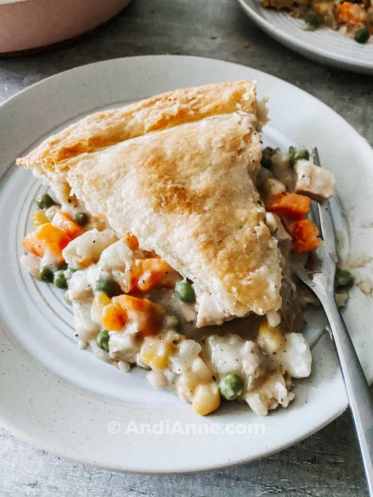 turkey pot pie on plate with a fork