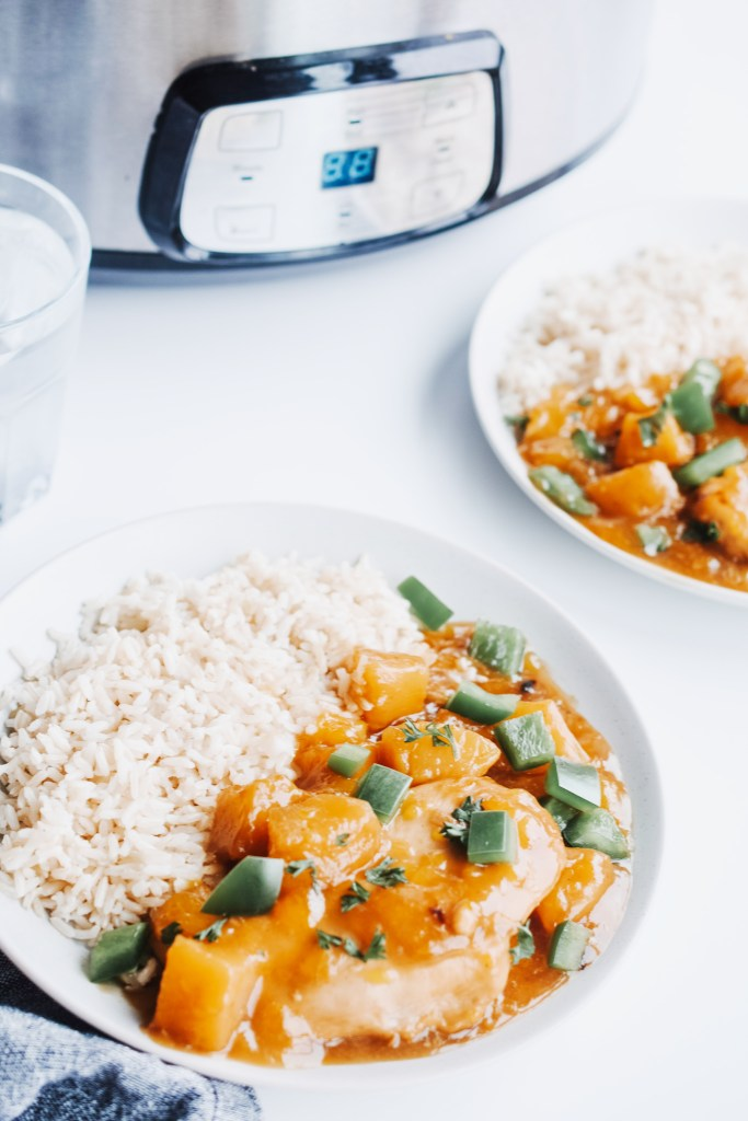 slow cooker pineapple orange chicken recipe on plates with rice