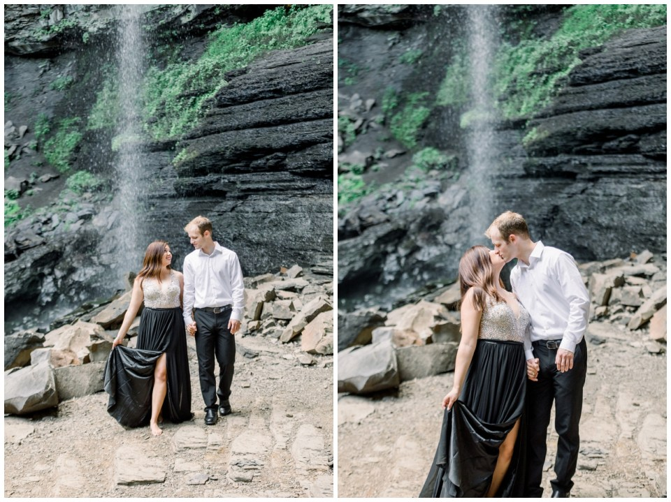 Couple walking and smooching under waterfall |Petit Jean Engagement|Waterfall engagement|  Petit Jean State Park| Tulsa Wedding Photographer| Arkansas wedding photographer| Arkansas Engagement| Destination Wedding Photographer| Andi Bravo Photography| andibravophotography.com