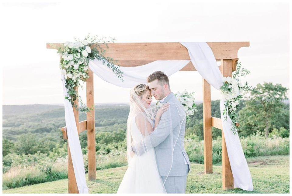 Bride and groom in gorgeous lighting outside at alter| Outdoor wedding| The View At Hillside Barn Wedding| Countryside Wedding|  Tulsa Wedding Photographer| Andi Bravo Photography