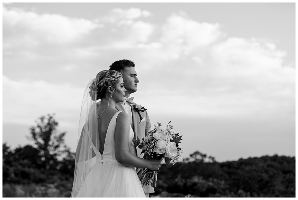 Black and white shot of couple staring out across countryside| The View At Hillside Barn Wedding| Countryside Wedding|  Tulsa Wedding Photographer| Andi Bravo Photography