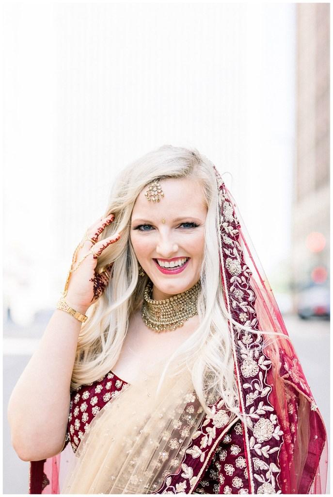 Beaming bride in crimson and gold Indian Hindu wedding ceremonial attire| Indian wedding Tulsa| Tulsa wedding photographer| Destination wedding photographer| Andi Bravo Photography
