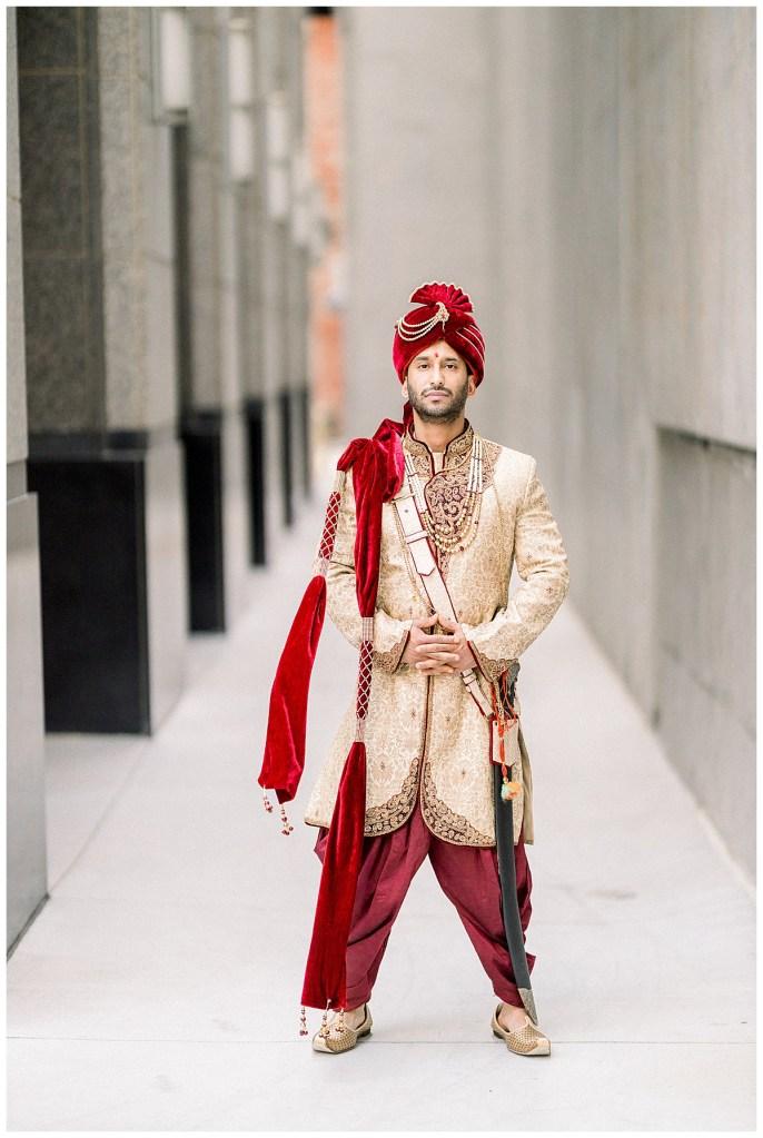 Indian groom standing in crimson and gold Hindu ceremonial wedding attire| Indian wedding Tulsa| Tulsa wedding photographer| Destination wedding photographer| Andi Bravo Photography