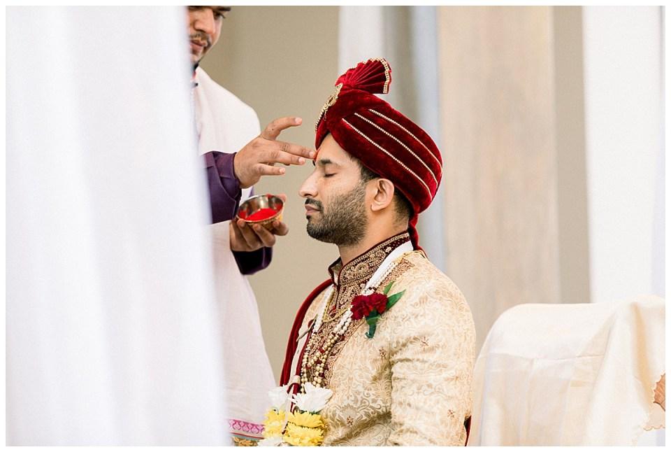 Hindu ceremonial paint being added to groom's forehead| Indian wedding Tulsa| Hindu wedding Tulsa| Tulsa wedding photographer| Andi Bravo Photography