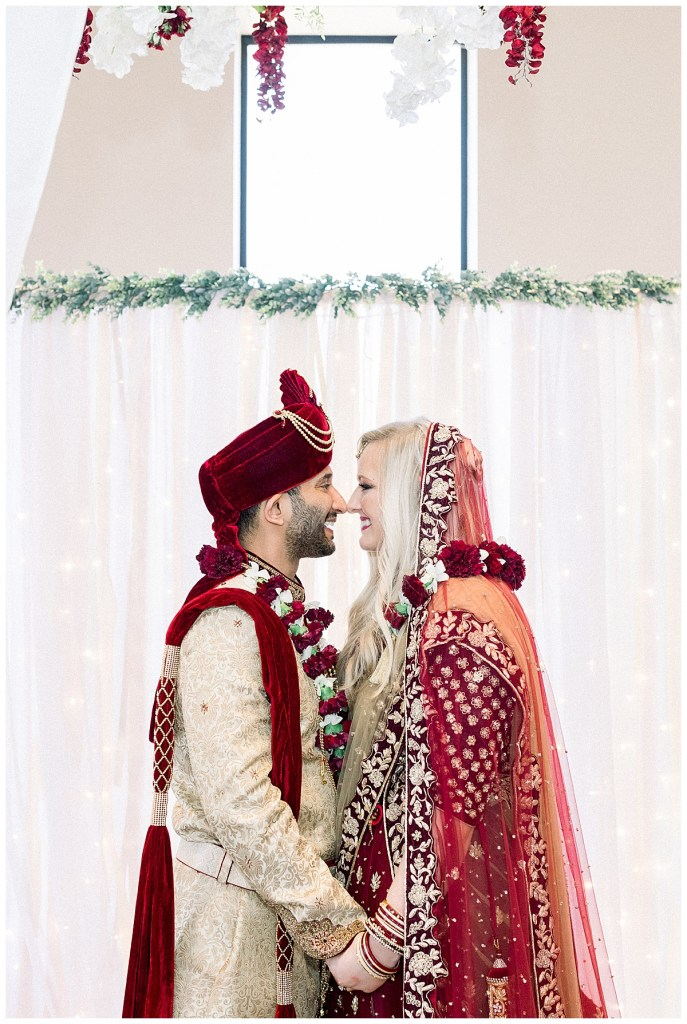 Bride and groom join hands and face nose to nose| Hindu wedding ceremony| Tulsa wedding| Andi Bravo Photography