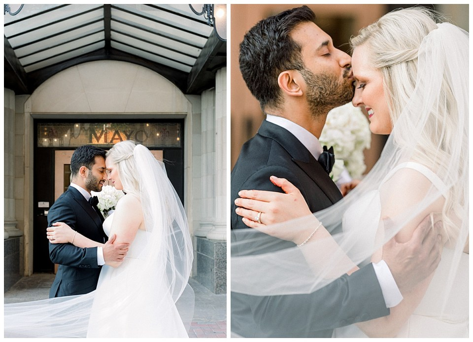 Bride and groom nuzzle and groom kisses bride on forehead while veil sweeps around them| The Mayo Hotel Wedding| Tulsa wedding photographer| Destination wedding photographer| Andi Bravo Photography