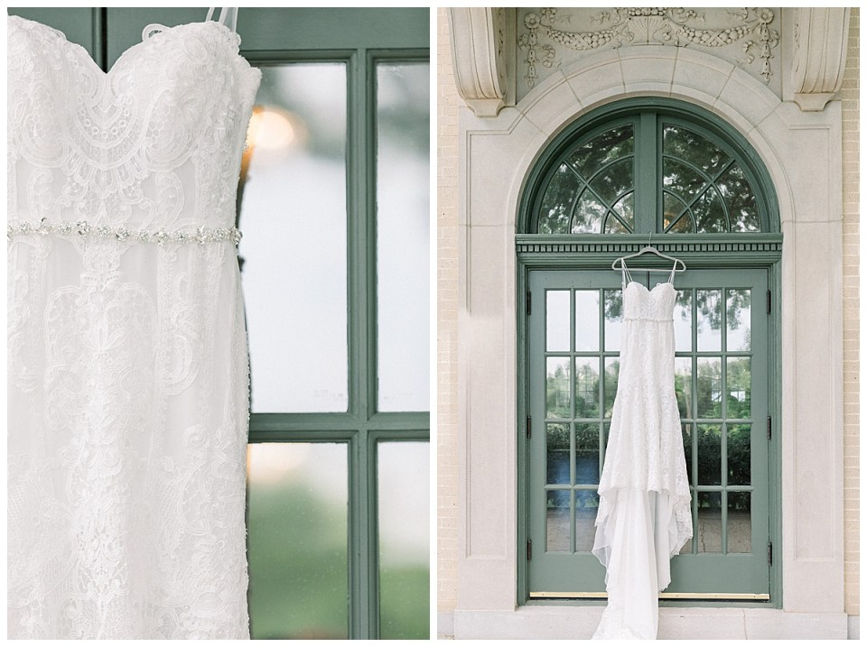 Lace strap wedding gown with silver crystal belt hanging from beautiful green French doors of The Mansion at Woodward Park| Tulsa wedding venue| Andi Bravo Photography | Tulsa wedding details