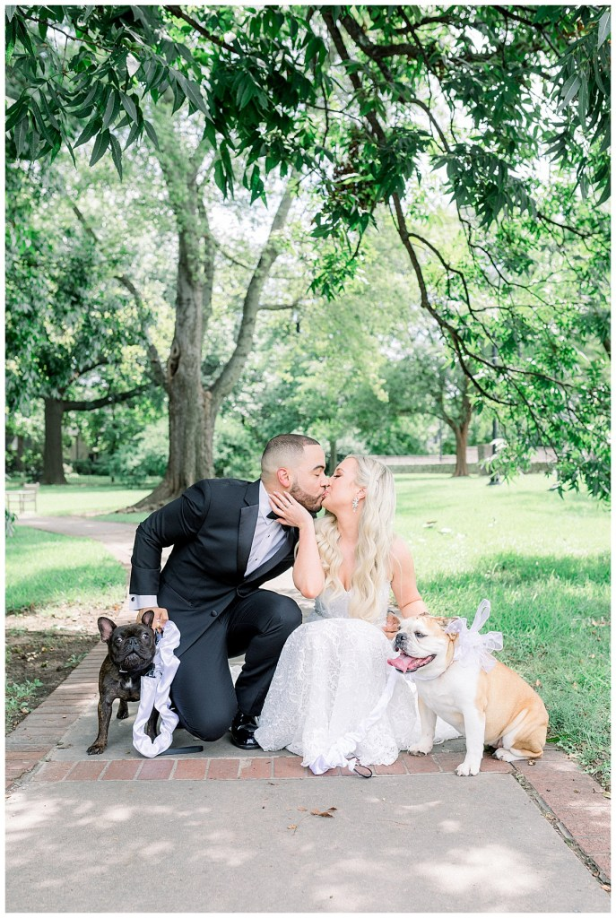 Bride and groom kiss while holding their dogs at their side| Tulsa wedding photographer| Andi Bravo Photography