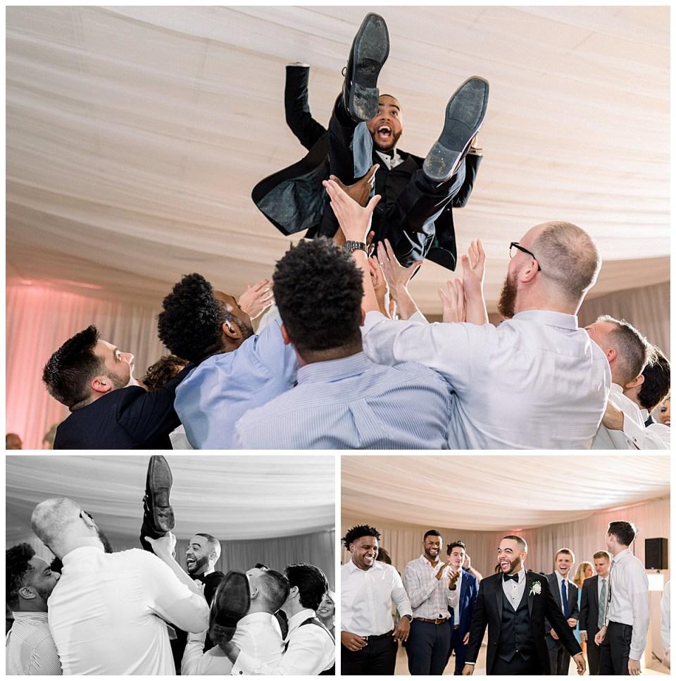 Groom crowd surfs at wedding reception| Tulsa weddings| Tulsa wedding venue| the Mansion at Woodward Park| Tulsa & destination wedding photographer| Andi Bravo Photographer