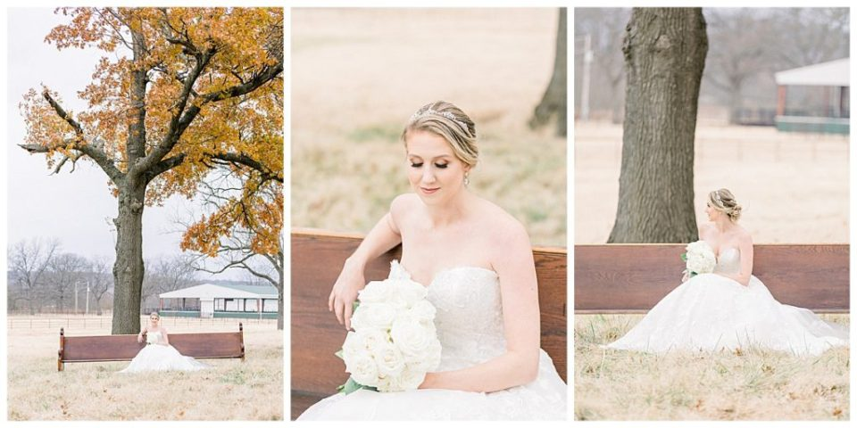 Bride sitting on bench under large tree at Pecandarosa Ranch Tulsa wedding venue