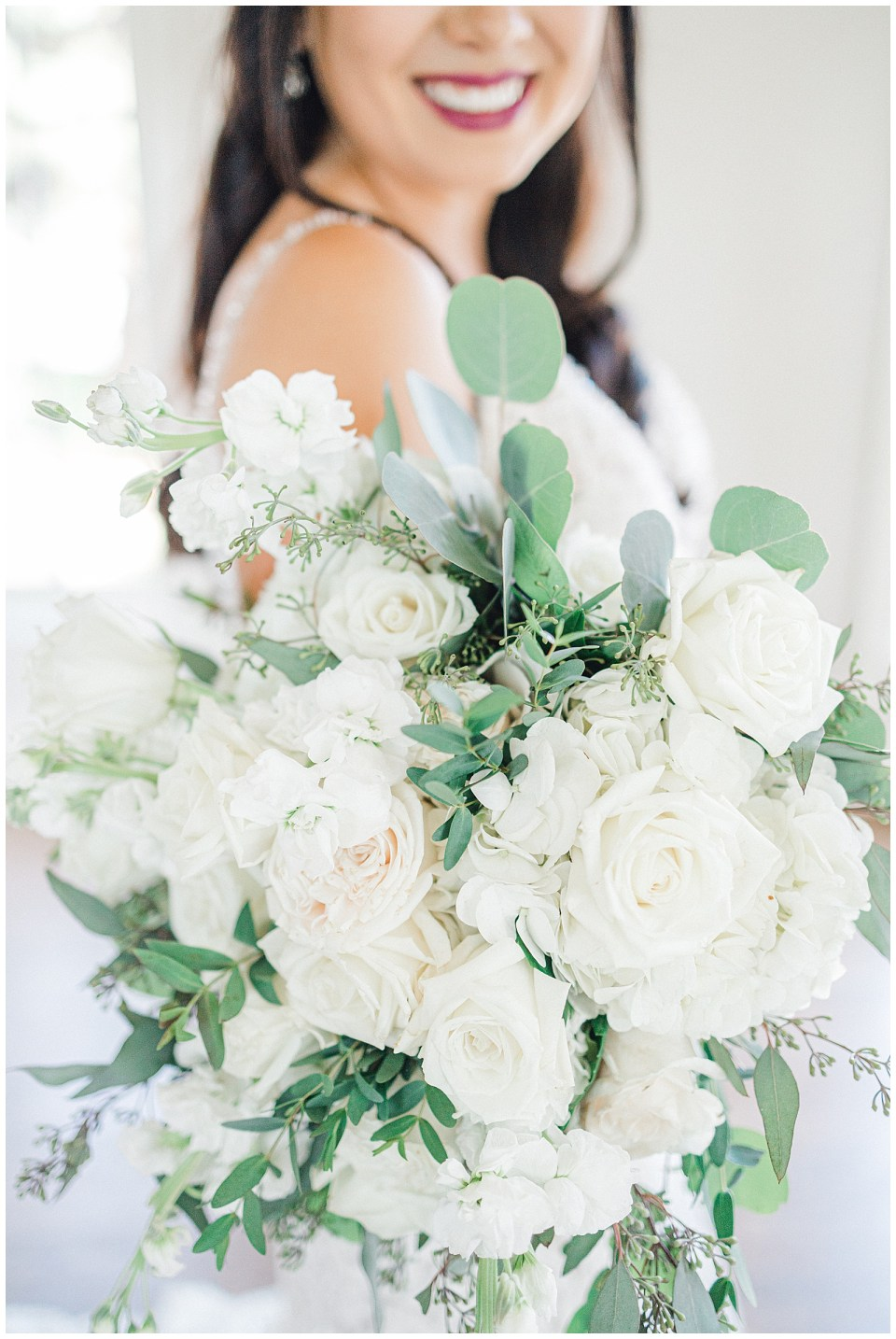 Bride holding white rose bouquet in Tulsa bridal session Mansion at Woodward Park
