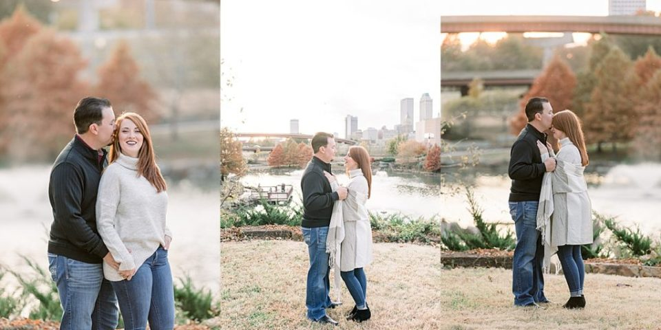Couple kissing at Downtown Tulsa Centennial Park engagement