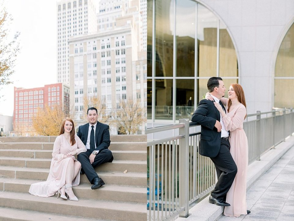 Couple sitting on stairs and embracing in Downtown Tulsa engagement session