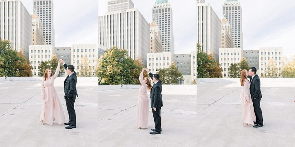 Couple dancing on downtown Tulsa rooftop
