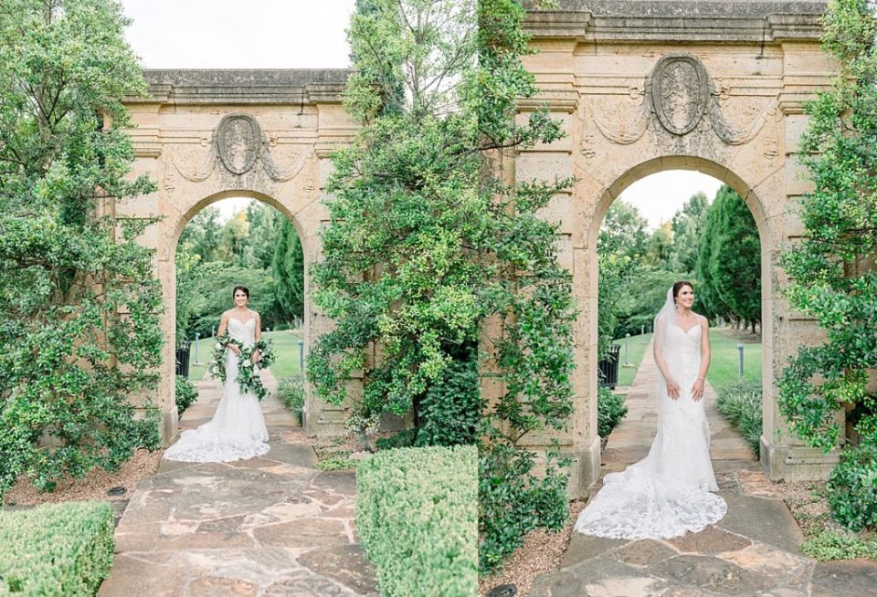 Bride walking through arch in garden at Tulsa Philbrook