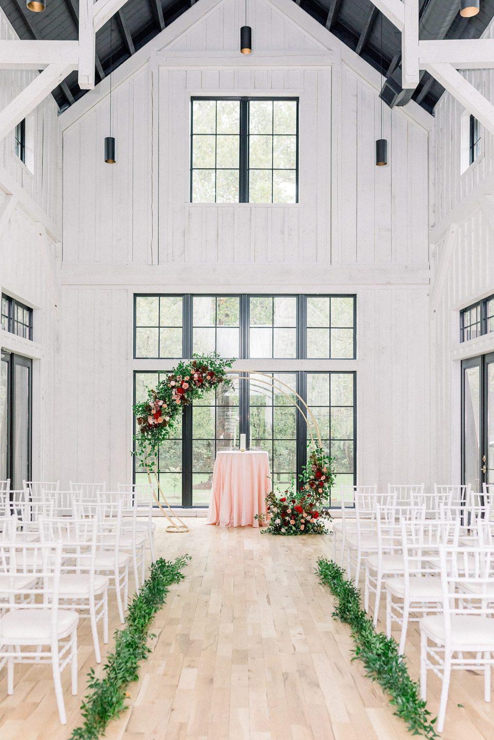 Round wedding arch ceremony setup at black barn at Spain Ranch wedding