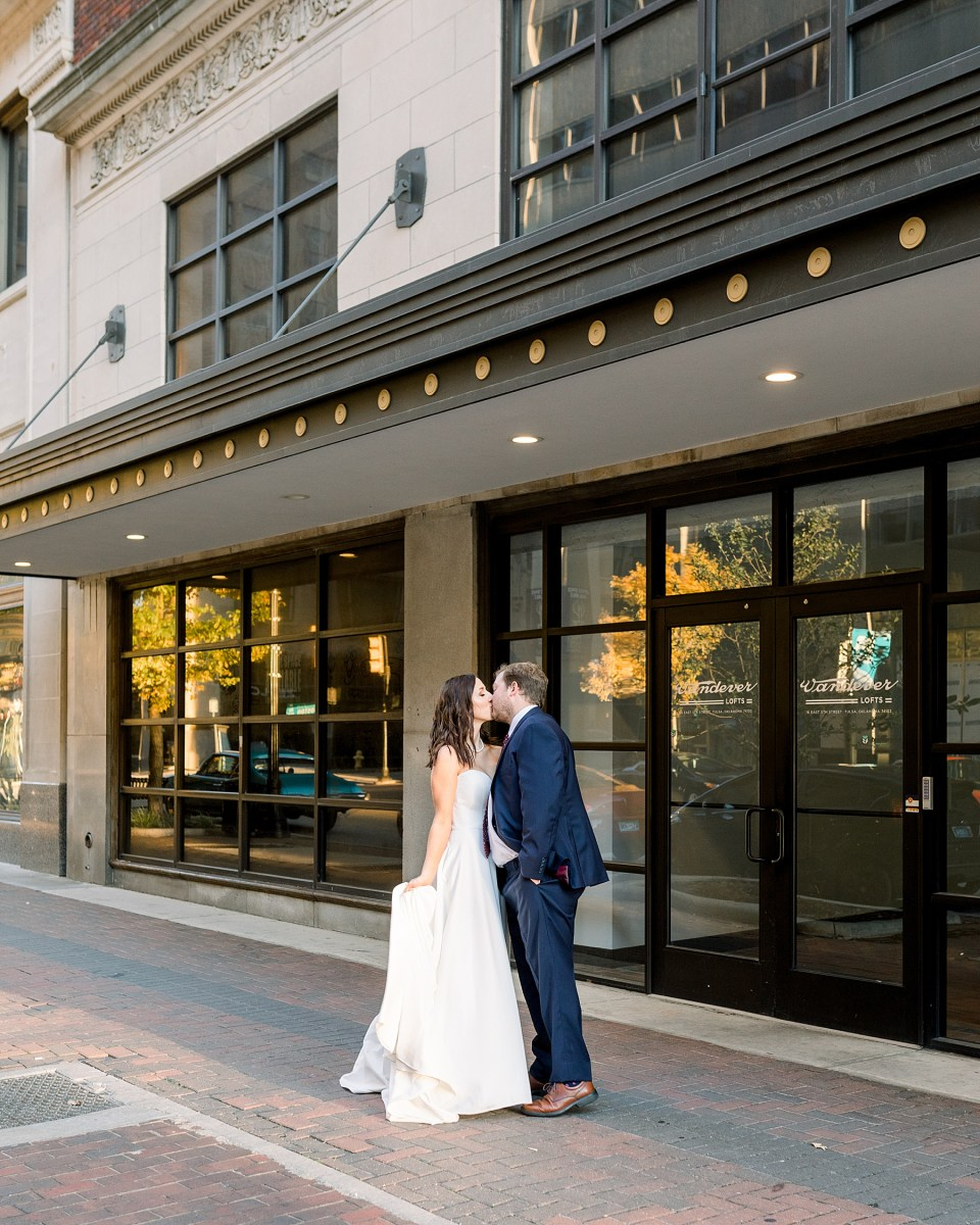 Bride and groom kissing in downtown Tulsa