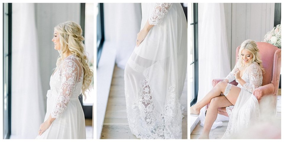 Bride in lacy white robe while getting ready