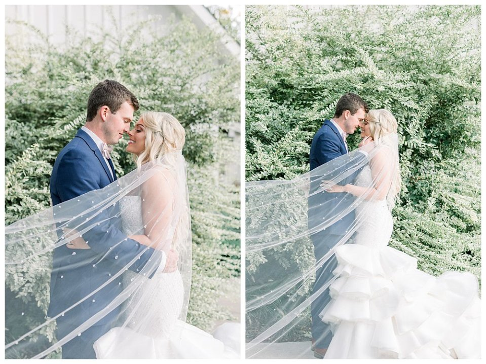 Bride and groom nuzzle and kiss under sweeping crystal veil at Spain Ranch