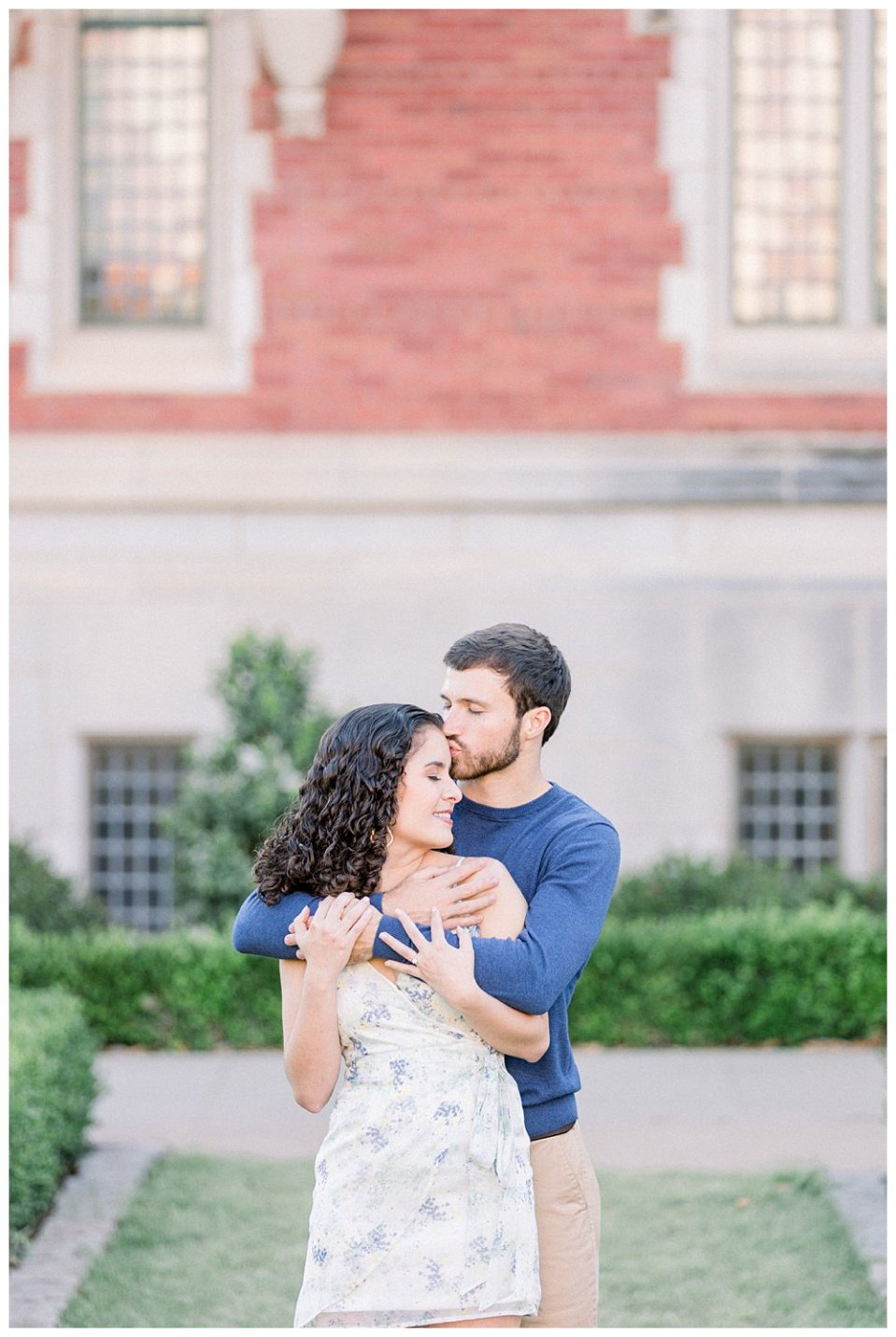 Guy hugging girl from behind kissing her