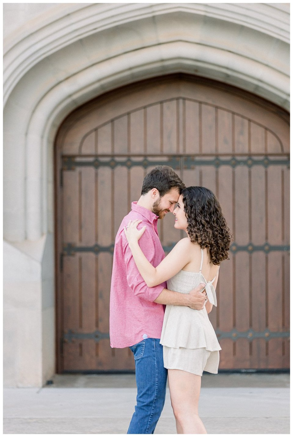 Couple embracing in OU engagement session