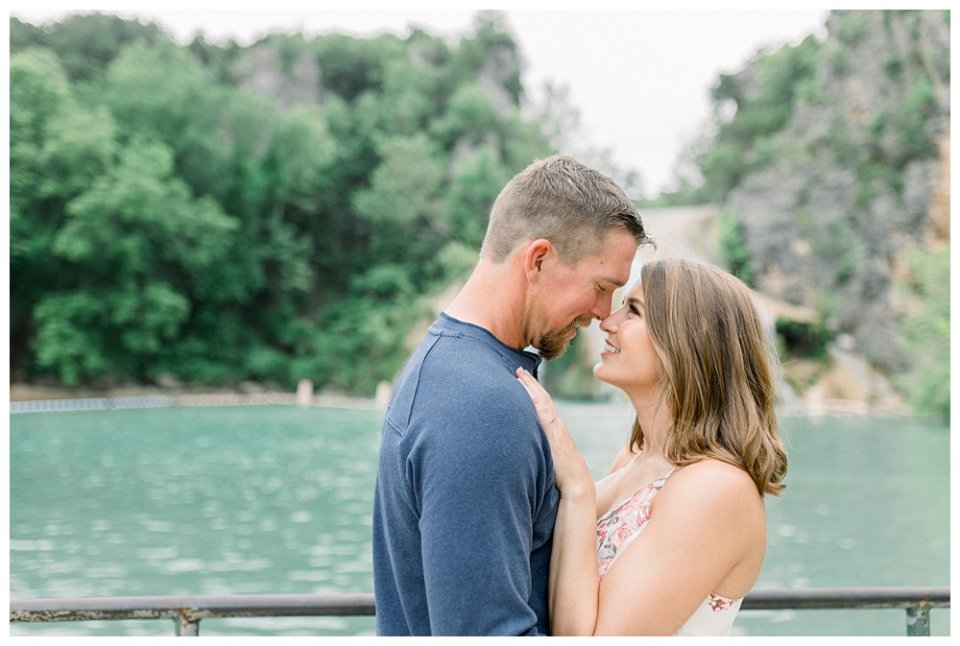 Couple nuzzling in Turner Falls engagement session