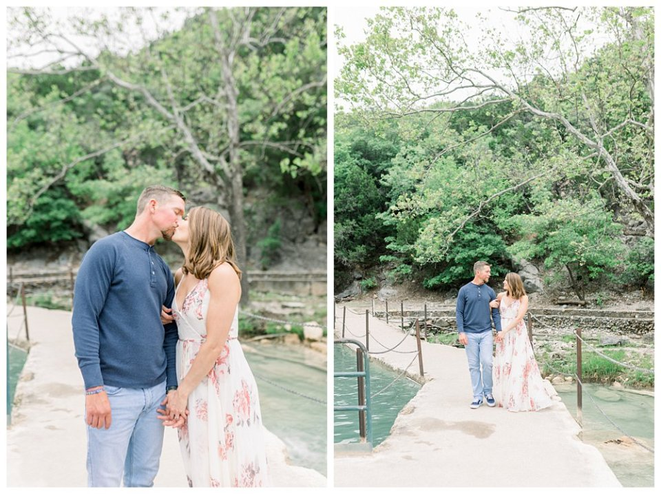 Couple walking along path and kissing at Turner Falls engagement session