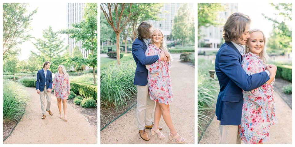 Couple cuddling and walking along garden path  in Guthrie Green / Centennial Park Tulsa engagement