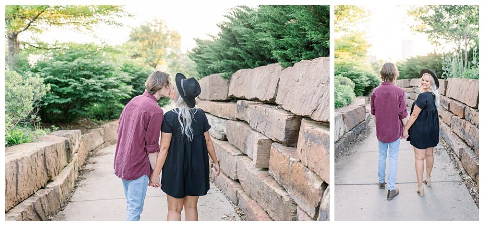 Couple holding hands walking down path  in Guthrie Green / Centennial Park Tulsa engagement