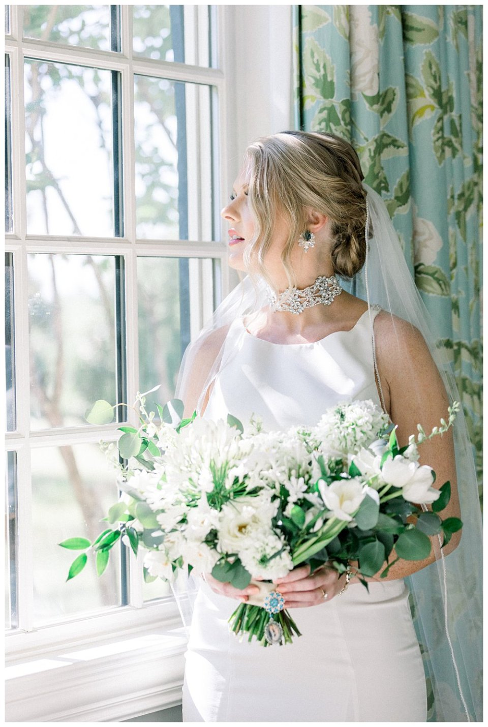 bride holding wedding bouquet with something blue locket