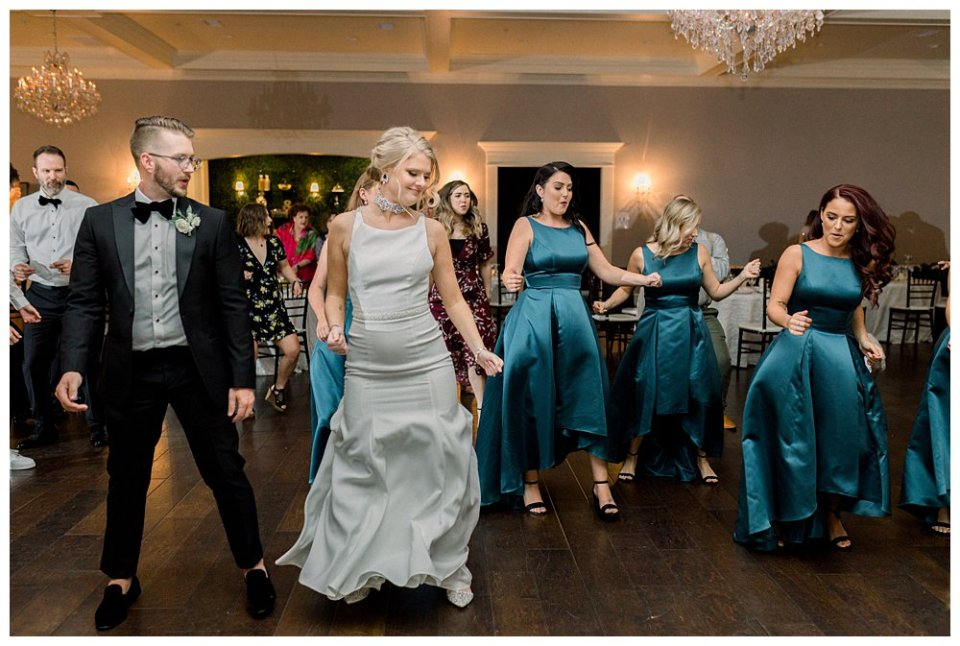 Bridal party dancing at reception at The Milestone
