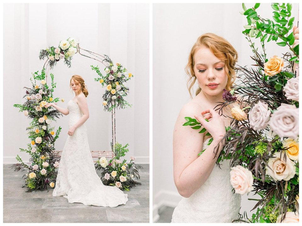 Bride standing next to floral arch in vintage Willow Creek Mansion bridal session