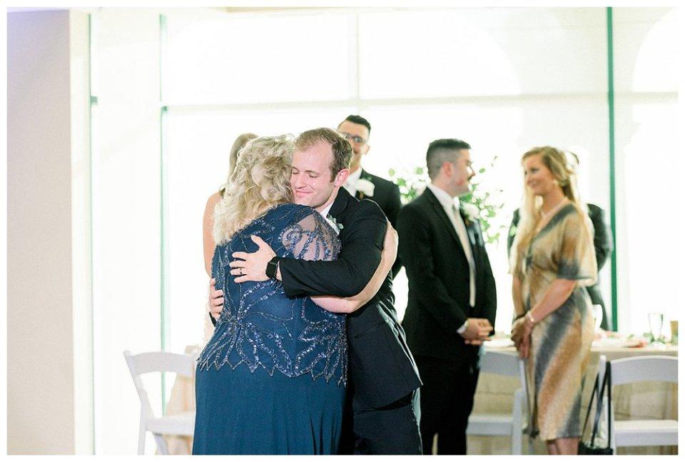 Groom and mother hug after dance