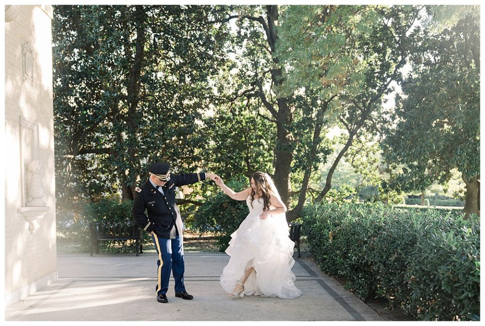 Groom twirling bride in first look at Tulsa Garden Center Mansion at Woodward Park elopement Stunning  Timeless Tulsa Photographer