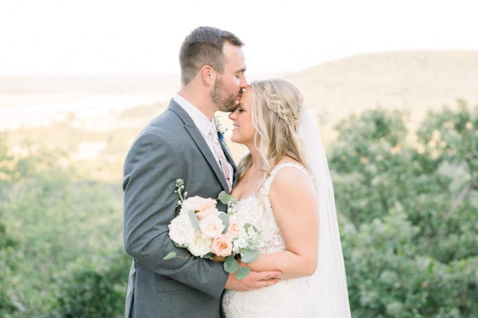 Bride and groom posing for stunning wedding portraits, at Dream Point Ranch