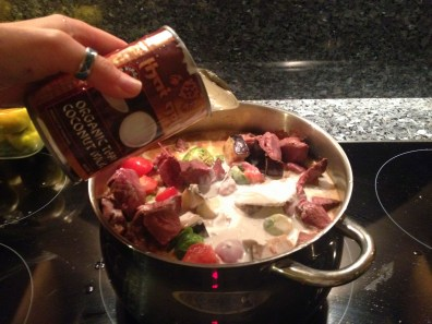 Adding meat, coconut milk, and water