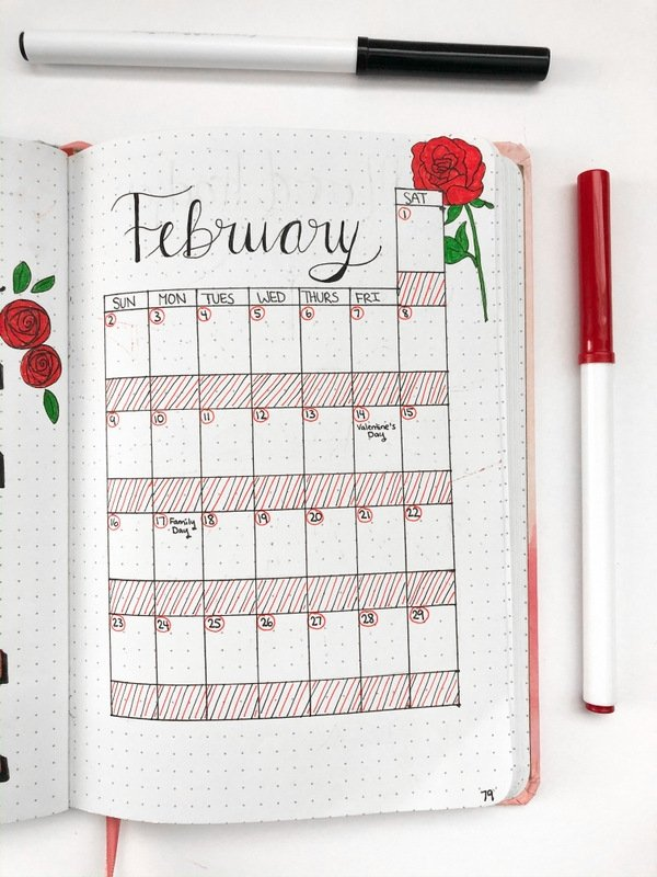 February bullet journal calendar with red roses