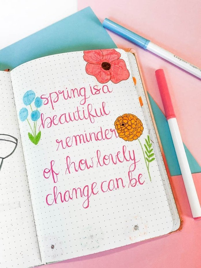 Bullet journal spring quote page with wildflowers