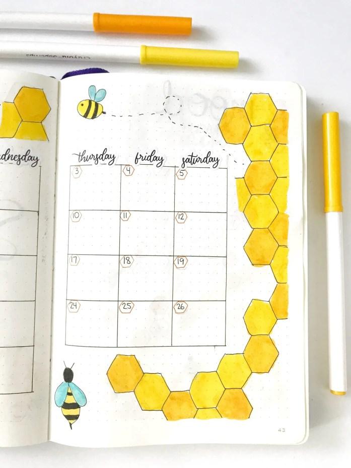 September bullet journal monthly calendar with honeybee theme