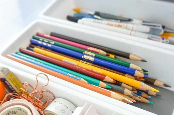stationery and office supplies inside plastic organizers