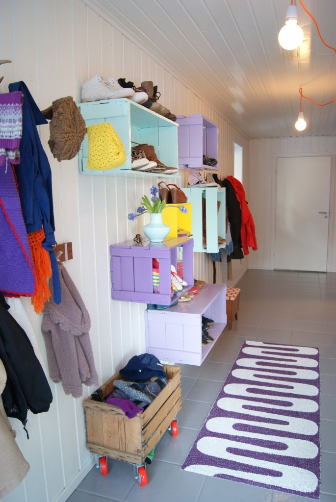 Love this! Great painted crates on the wall. Perfect shoe organization and storage.